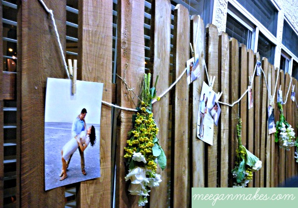 Wooden Fence with Engagement pictures and flowers