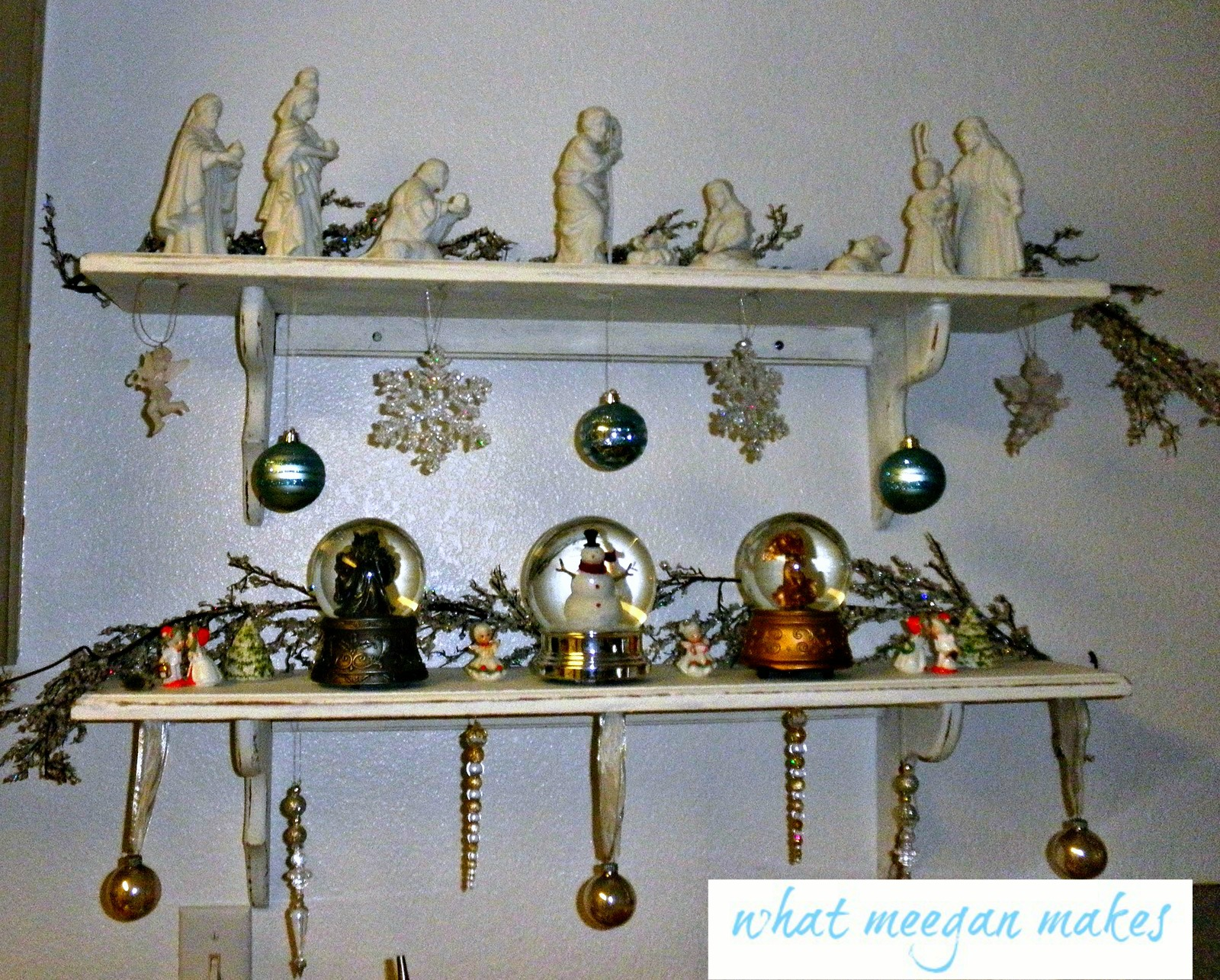i love white and blue as you know already the kissing carolers are from my grandmas christmas decoration collection - Christmas Shelf Decorations