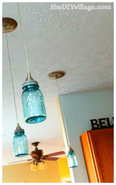 three hanging jars lighting