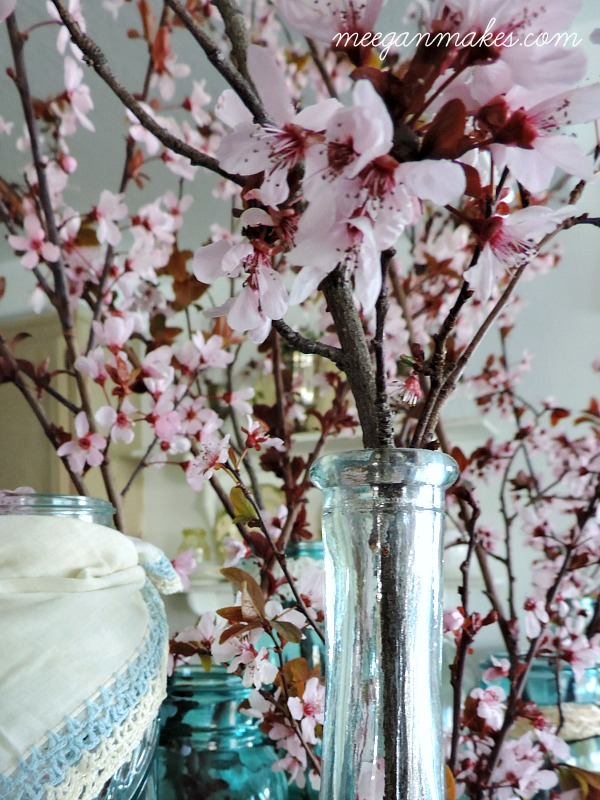 Cherry Blossoms for Spring Decorating. I love them in vintage blue bottles and jars.