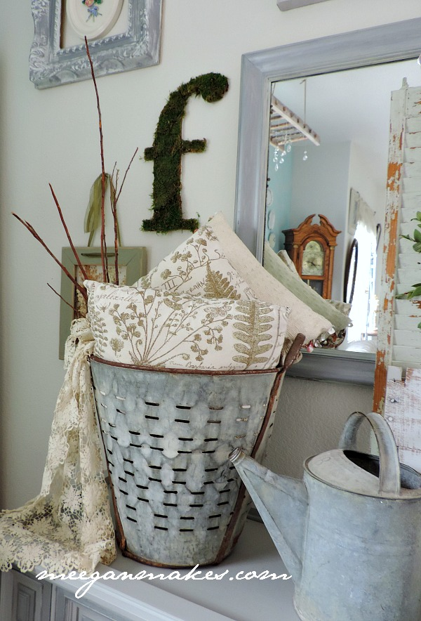 Spring Decorating with an Olive Bucket filled with Botancial Pillows