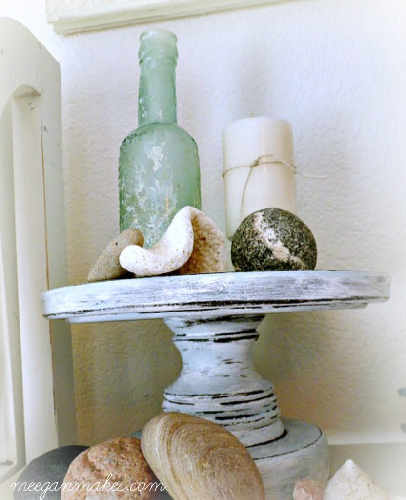 Shells with a vintage bottle and rocks. I love this on a pedestal.