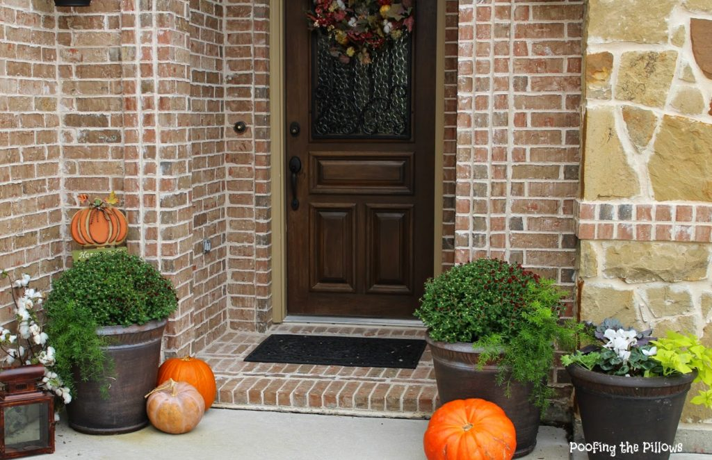 tiny porch with pumpkins and cotton