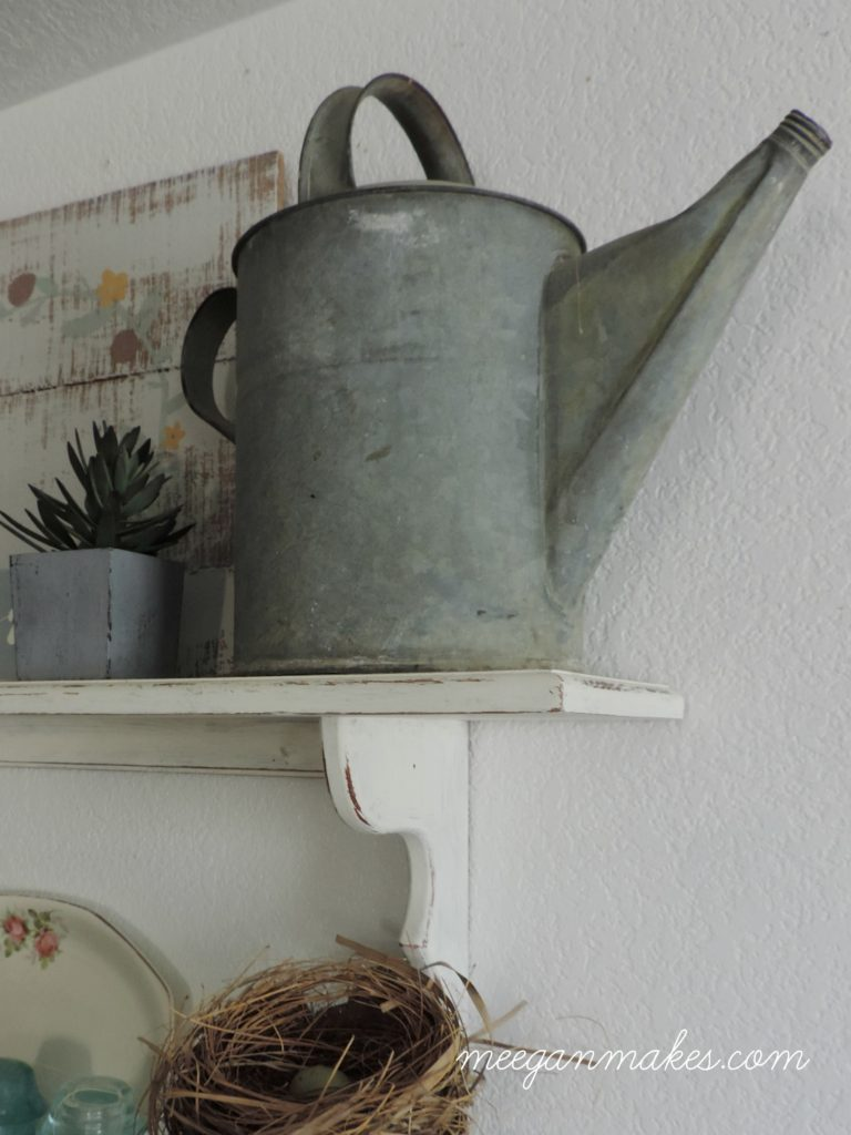 Galvanized Watering Can On Open Shelves