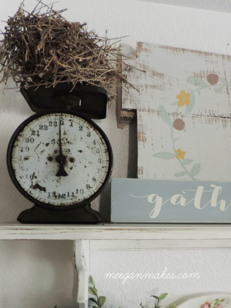 Vintage Scale and Birds Nest on Open Shelves