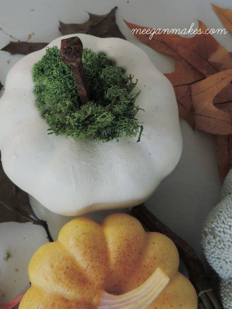 pumpkin-craft-with-moss-and-rusty-nail-as-a-stem