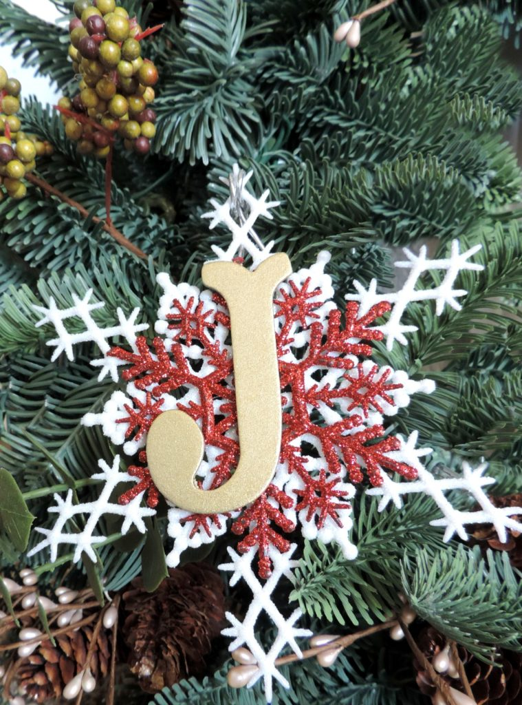 i then hot glued the monogram to the center of the red glittered snowflake for a hanger tie a pretty glitter string to the top of your ornament